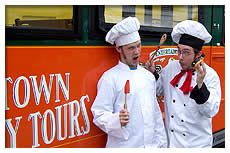 two chefs standing in front of trolley