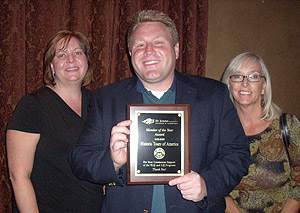 three people holding award