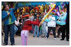 girl hitting a pinata
