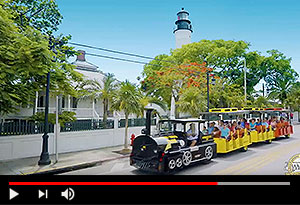 video screen showing conch tour train in key west driving past key west lighthouse