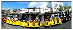 conch tour train driving by sloppy joes