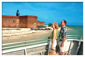 couple looking at Fort Jefferson from boat