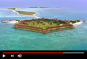 video screen showing aerial view of fort jefferson on the water