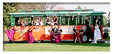 wedding party standing outside trolley
