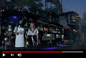 video screen showing key west ghost hosts in front of ghost tour trolley