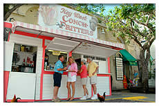 tourists buying conch fritters at stand