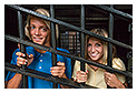 tourists inside jail cell