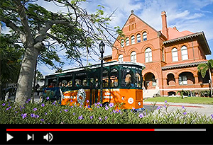 video screen showing old town trolley driving past customs house in key west