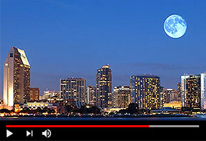 video screen showing moon and san diego skyline lit up at night