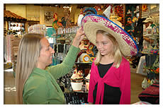 mother and daugher trying on mexican hat