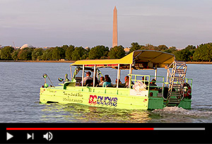 video screen showing dc ducks vehicle on water with washington monument in background