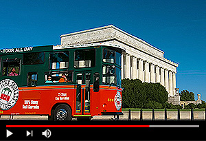 video screen showing washington dc trolley driving past lincoln memorial