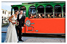 bride and groom getting on the trolley