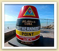"picture of southernmost buoy marker in Key West showing the words ""90 miles to Cuba, Southernmost Point, Continental U.S.A., Key West, FL"""